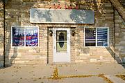 16 SEPTEMBER 2020 - MITCHELLVILLE, IOWA: A Donald Trump flag in a window in Mitchellville, IA.        PHOTO BY JACK KURTZ