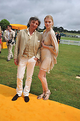LEON MAX and KATYA ELIZAROVA at the 2011 Veuve Clicquot Gold Cup Final at Cowdray Park, Midhurst, West Sussex on 17th July 2011.
