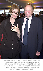 TV presenter CLIVE ANDERSON and MRS ANDERSON at a party in London on 1st May 2002.OZN 118