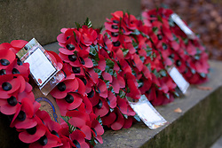 © Licensed to London News Pictures. 11/11/2012. Whitchurch-on-Thames, Reading, Berkshire. Wreaths laid by local people of the Parishes of Whitchurch-on-Thames and Goring Heath gather at the War Memorial on Whitchurch Hill to remember the fallen on Remembrance Sunday, at a Memorial Service. Rev Claire Alcock took the service in amongst the autumnal beech trees at the memorial purposely built between the two parishes. Photo credit : Rebecca Mckevitt/LNP