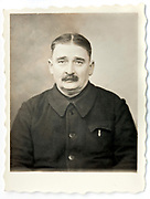 vintage identity style head and shoulder portrait of a adult man