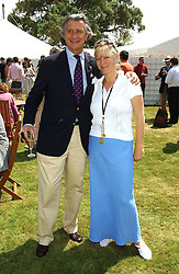 "MON.ARNAUD BAMBERGER and the COUNTESS OF MARCH at a luncheon hosted by Cartier at the 2005 Goodwood Festival of Speed on 26th June 2005.  Cartier sponsored the ""Style Et Luxe' for vintage cars on the final day of this annual event at Goodwood House, West Sussex. <br />