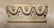 """Picture of Roman relief sculpted Sarcophagus of Garlands, 2nd century AD, Perge. This type of sarcophagus is described as a """"Pamphylia Type Sarcophagus"""". It is known that these sarcophagi garlanded tombs originated in Perge and manufactured in the sculptural workshops of Perge. Antalya Archaeology Museum, Turkey.. Against a warm art background. ..<br /> <br /> If you prefer to buy from our ALAMY STOCK LIBRARY page at https://www.alamy.com/portfolio/paul-williams-funkystock/greco-roman-sculptures.html . Type -    Antalya    - into LOWER SEARCH WITHIN GALLERY box - Refine search by adding a subject, place, background colour, etc.<br /> <br /> Visit our ROMAN WORLD PHOTO COLLECTIONS for more photos to download or buy as wall art prints https://funkystock.photoshelter.com/gallery-collection/The-Romans-Art-Artefacts-Antiquities-Historic-Sites-Pictures-Images/C0000r2uLJJo9_s0"""