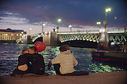 Saint Petersburg, Russia, June 2002..White Nights by the River Neva - young lovers await the raising of Palace Bridge on the River Neva for the night shipping.