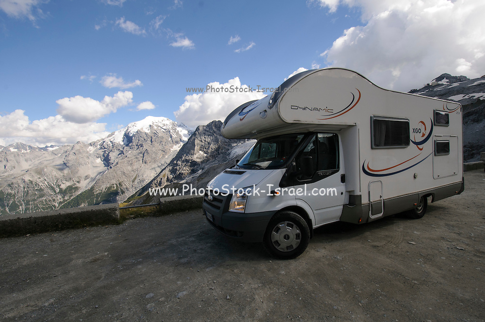 motor home vacation. Camper on the trail at Stelvio Mountain Pass, Italy at 2,758 meters above sea level