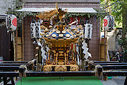 A mikoshi at a local community office in preperation for the Sanja matsuri in Asakusa, Tokyo, Japan. Friday May 13th 2016. The Sanja matsuri is one of the biggest festivals in Japan. Taking place over the 3 days of the second weekend of May (May 13th to 15th) it features many mikoshi, or portable shrines, that are carried around by local groups to bring blessings and prosperity to their neighbourhoods