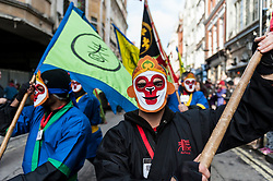 © Licensed to London News Pictures. 14/02/2016. London, UK.   Dancers with monkey masks during the Chinese New Year parade around Chinatown celebrating the Year of the Monkey. Photo credit : Stephen Chung/LNP