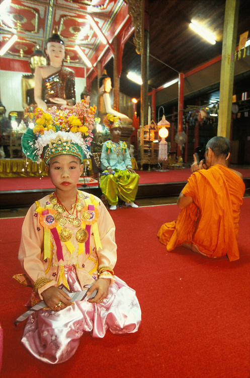 Boys pose for photgraphs after they have been dressed up as princes at Poy Sang Long, the yearly ordination of novice monks in Mae Hong Son, Thailand.
