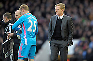 Swansea City Manager Garry Monk looks on as Goalkeeper Gerhard Tremmel is being subbed on to replace Goalkeeper Lukasz Fabianski of Swansea City who was sent off. Barclays Premier league match, West Ham Utd v Swansea city at the Boleyn ground, Upton Park in London on Sunday 7th December 2014.<br /> pic by John Patrick Fletcher, Andrew Orchard sports photography.