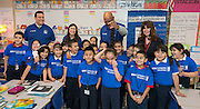 Former NBA play John Lucas poses for a photogrpah with students during a financial education and success program sponsored by NBA Cares and BBVA Compass at Crespo Elementary School, February 27, 2014.