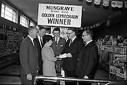 19/09/1967<br /> 09/19/1967<br /> 19 September 1967<br /> Musgrave-Brooke Bond Ltd. presentation at  Connolly's Supermarket, Patrick Street, Dun Laoghaire. Picture shows the  presentation of a cheque for £100 to Mrs Elizabeth Sharkey, the Musgrave Golden Leprechaun competition winner.