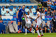 Cardiff City forward Kieffer Moore  (10) competes for a high ball with Bournemouth midfielder Jefferson Lerma (8) during the EFL Sky Bet Championship match between Cardiff City and Bournemouth at the Cardiff City Stadium, Cardiff, Wales on 18 September 2021.