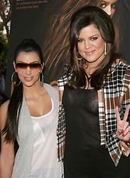 Kim Kardashian and Khloe Kardashian attending the unveiling of Khloe Kardashian's cheeky new PeTA billboard 'Fur? I'd Rather Go Naked' on Melrose Avenue in Los Angeles, CA, USA on December 10, 2008. Photo by Debbie VanStory/ABACAPRESS.COM  | 172635_004
