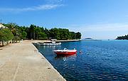 Boats moored at Franciscan monastery and church, island of Badija, Croatia