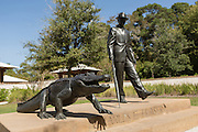 Statue of Charles E. Fraser walking an alligator in Compass Rose Park on Hilton Head Island, SC