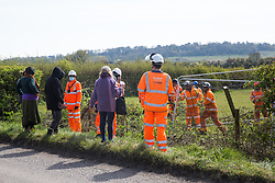 Quainton, UK. 26th April, 2021. Stop HS2 activists monitor hedgerow clearance works during the bird nesting season for a temporary access road for the HS2 high-speed rail link. Environmental activists continue to oppose the controversial HS2 infrastructure project from a series of protection camps along its Phase 1 route between London and Birmingham.
