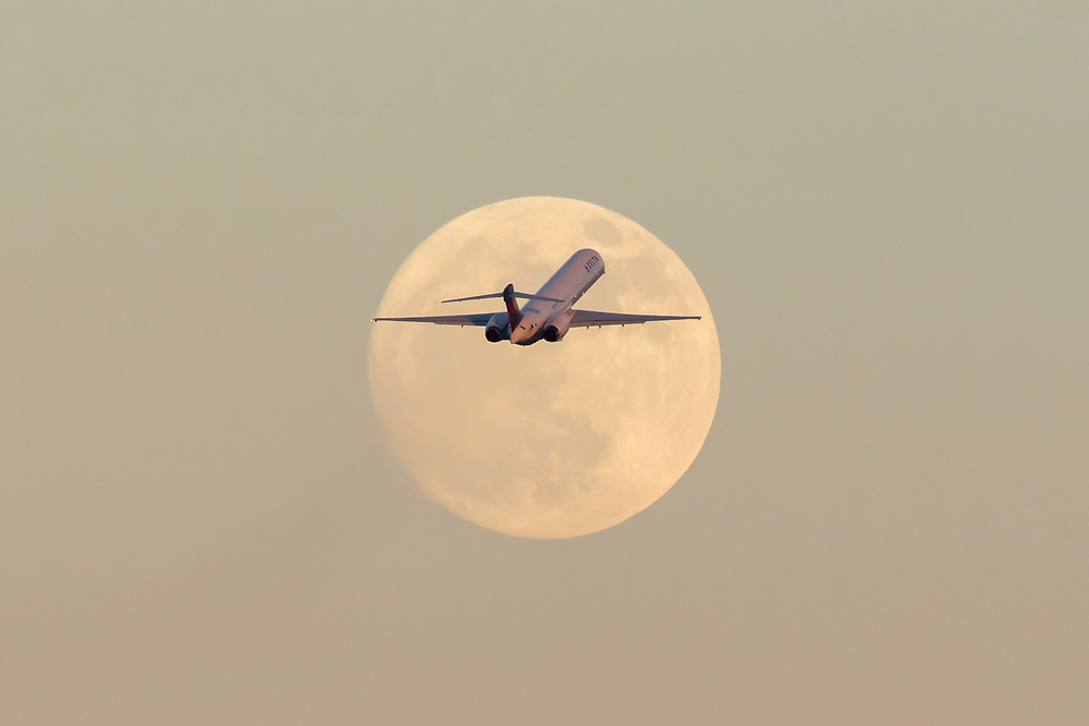 Dec. 2, 2017: A Delta Airlines MD90 departs Miami International Airport with the rising Super Moon.