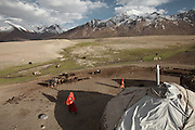 Overview of Er Ali Boi's summer camp. The borders of Tajikistan and China are at the far end of the plateau. The borders are sealed and guarded..Summer camp of Muqur, Er Ali Boi's place...Trekking through the high altitude plateau of the Little Pamir mountains (average 4200 meters) , where the Afghan Kyrgyz community live all year, on the borders of China, Tajikistan and Pakistan.