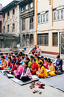 A group of women during their morning puja in Patan, Nepal.