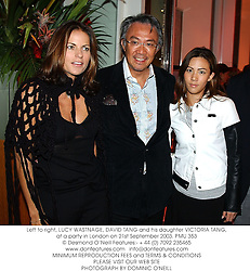 Left to right, LUCY WASTNAGE, DAVID TANG and his daughter VICTORIA TANG, at a party in London on 21st September 2003.PMU 353