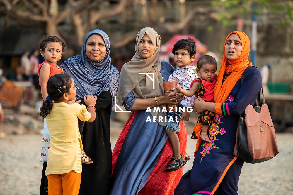 Kochi, India - 05 April 2019: view of a family on the beach in Kochi, Kerala, India.