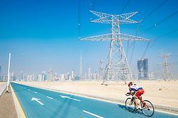 Cyclist on new cycle track at District One at new property development in Dubai United Arab Emirates