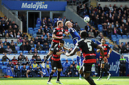 Cardiff City's Lex Immers (c) is challenged by QPR's Clint Hill for a header. Skybet football league championship match, Cardiff city v Queens Park Rangers at the Cardiff city stadium in Cardiff, South Wales on Saturday 16th April 2016.<br /> pic by Carl Robertson, Andrew Orchard sports photography.
