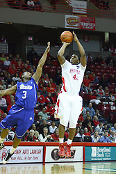 30 January 2011: Austin Hill gets off a shot ahead of defense provided by Kurt Alexander during an NCAA basketball game between the Drake Bulldogs and the Illinois State Redbirds. The Redbirds win in OT 77-75 after a last three point shot by Drake was ruled too late at Redbird Arena in Normal Illinois.