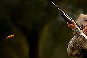 PMM#281109_The Chase_ Chancelaria Velha, Alter do Chão, Alentejo, Portugal. A woman hunter shooting a grouse.