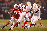 Ndamukong Suh pursues Arizona quarterback Nick Foltz during a 33-0 win in the Holiday Bowl on Dec. 30, 2009. © Aaron Babcock