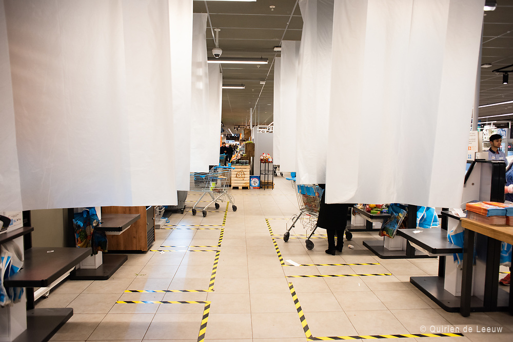 Screens of sheets are placed for protection and as part of the one and a half meter protection measures.