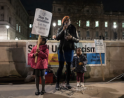 © London News Pictures. London, UK. 29/02/16. Shakira Martin, from the National Union of Students, speaks at a demonstration opposite Downing Street against the demolition of the 'Jungle' camp in Calais. French authorities have begun to evict the camp's residents, thought to number 5,500. . Photo credit: Rob Pinney/LNP