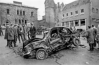 Locals peruse the remains of a Provisional IRA 500lb car bomb and the resultant damage caused to Market Square, Dungannon, 14th February 1974. Despite widespread damage there were no casualties. 197402140113A<br /><br />Dungannon; bomb; damage; 113/74<br /><br />Copyright Image from Victor Patterson, 54 Dorchester Park, <br />Belfast, UK, BT9 6RJ<br /><br />t1: +44 28 9066 1296 (from Rep of Ireland 048 9066 1296)<br />t2: +44 28 9002 2446 (from Rep of Ireland 048 9002 2446)<br />m: +44 7802 353836<br /><br />victorpatterson@me.com<br />victorpattersonbelfast@gmail.com<br /><br />Please see my Terms and Conditions of Use at victorpatterson.com. It is IMPORTANT that you familiarise yourself with them.<br /><br />Images used on the Internet incur an additional cost and must be visibly watermarked i.e. ©Victor Patterson within the body of the image and copyright metadata must not be deleted. Images used on the Internet have a size restriction of 4kbs and are chargeable at rates available at victorpatterson.com.<br /><br />This image is available only for the use of the download recipient i.e. television station, newspaper, magazine, book publisher, etc, and must not be passed on to any third party. It is also downloaded on condition that each and every usage is notified within 7 days to victorpatterson@me.com<br /><br />The right of Victor Patterson (or the named photographer) to be identified as the author is asserted in accordance with The Copyright Designs And Patents Act (1988). All moral rights are asserted.