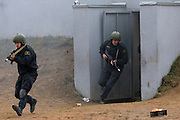 Moscow, Russia, 29/10/2008..Soldiers exit a bunker during Russian special forces training at a military base just outside Moscow. The exercise was part of the Interpolitex 2008 state security exhibition.