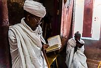 Ethiopian Orthodox priest praying, Bete Maryam (St. Mary's Church), one of 11 rock hewn churches in Lalibela, Ethiopia.