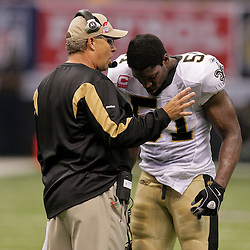 2009 October 04: New Orleans Saints linebacker Jonathan Vilma (51) talks with defensive coordinator Gregg Williams on the sideline during a 24-10 win by the New Orleans Saints over the New York Jets at the Louisiana Superdome in New Orleans, Louisiana.