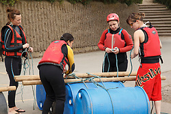 Instructor with group of visually impaired people doing raft-building activity at the National Water Sports Centre.