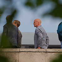 US actor Bruce Willis (C) with costars Jai Courtney (2nd L) of Australia and Sebastian Koch (L) of Germany are seen during a shooting of the fifth piece in the Die Hard series titled Good Day to Die Hard during a shooting day in Budapest, Hungary on May 19, 2012. ATTILA VOLGYI