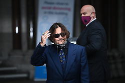 © Licensed to London News Pictures. 09/07/2020. London, UK. American Actors JOHNNY DEPP and AMBER HEARD arrives at the High Court in London where Depp he is in a legal dispute with UK tabloid newspaper The Sun over allegations he assaulted his former wife, Amber Heard. Photo credit: Ben Cawthra/LNP