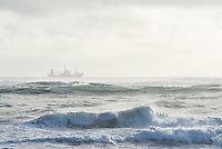 A fishing trawler in the ocean along the south coast of Iceland.