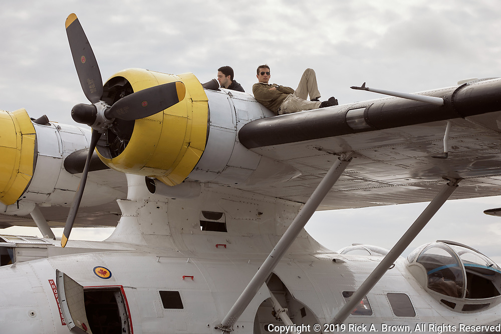 PBY crew resting on the wing at Warbirds Over the West.