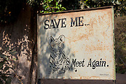 Save Tiger poster at exit of Ranthambhore National Park tiger reserve, Rajasthan, Northern India