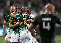 Frankie Horne of South Africa, South African captain Kyle Brown and Steven Hunt of South Africa celebrate after South Africa beat New Zealand to win the Cup Final during the Cup Final match between South Africa and New Zealand on Day 2 of the HSBC Sevens World Series Port Elizabeth Leg held at the Nelson Mandela Bay Stadium on 8th December 2013 in Port Elizabeth, South Africa. Photo by Shaun Roy/Sportzpics