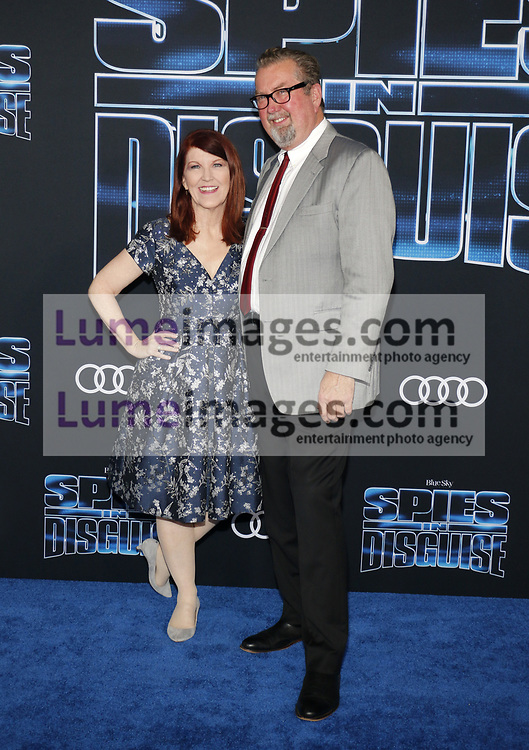 Kate Flannery and Chris Haston at the Los Angeles premiere of 'Spies In Disguise' held at the El Capitan Theatre in Hollywood, USA on December 4, 2019.