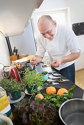 Chef preparing lentil salad in private kitchen