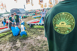 The rubbish is trampled into the mud but an army of voulunteers has already cleared a large area in the now empty West Holts area - the festival motto is 'Leave no trace'.The 2015 Glastonbury Festival, Worthy Farm, Glastonbury.