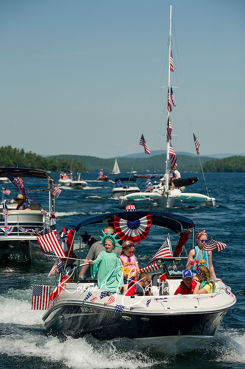"""""""Lady Liberty"""" Anna Herrmann on board the Herrmann/Forsberg boat during the Winnipesaukee Yacht Club's 4th of July boat parade head out from Saunders Bay Monday morning.  (Karen Bobotas/for the Laconia Daily Sun)"""