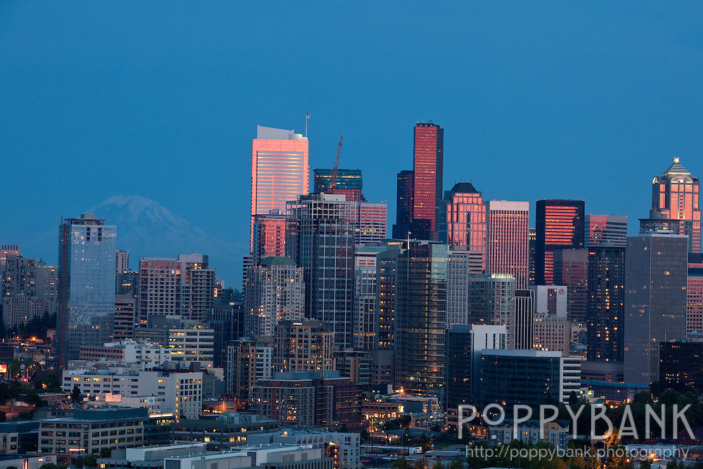 Sunset in Seattle Washington with Mount Rainier appearing in the background.