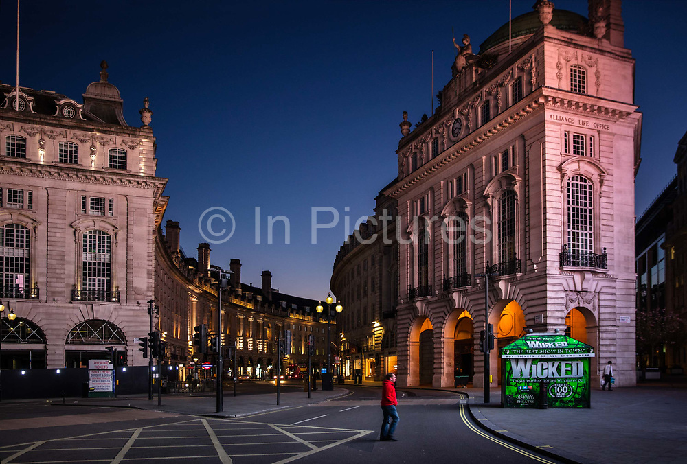 Piccadilly Circus and Regent Street, deserted at 7.30pm Saturday night during the Coronavirus pandemic on 4th April 2020 in London, United Kingdom. The government clampdown includes the closure of most shops, bars and theatres throughout the country.