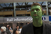man dressed up as Frankenstein in crazy costumes at Waterloo station on their way to the Rugby Sevens tournament. Fans of this sport have developed theeir own tradition of dressing up in costume to support their teams. London, UK.